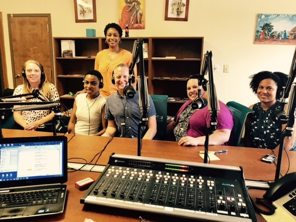 "Guests, (Seated, L-R), Laura Colbert, Executive Director, Georgians for a Healthy Future, Berneta Haynes, Director of Equity & Access for Georgia Watch, Bill Rencher, JD, MPH, Research Associate II, Health Policy Center, Georgia State University, Amanda Ptashkin, JD, Project Manager, Community Catalyst, Laura Harker, Policy Analyst, Georgia Budget & Policy Institute, join (Standing, Second Row) Clarkston Speaks Host, Shawanna Qawiy, in the studio to discuss ""Health Care Polices & Awareness."""